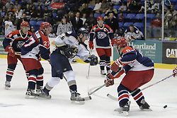 11 November 2006: Surrounded by Jackals, Mathieu Brunnelle takes a shot on goal.&#xD;The Elmira Jackals met the Bloomington PrairieThunder at the U.S. Cellular Coliseum in Bloomington Illinois.<br />