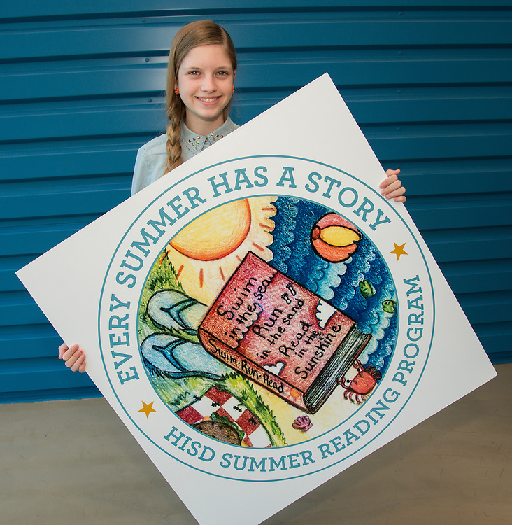Texas Connections Academy eighth grader Maggie Martin poses for a photograph with her winning artwork to promote the Houston ISD Summer Reading Program, April 25, 2014.