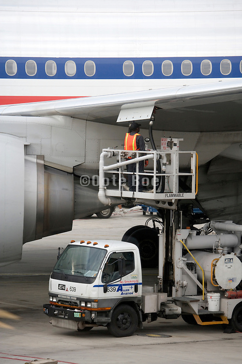 Airplane being refueled on the tarmac