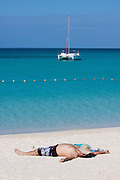 Miyako-jima. Maehama - Japan's most beautiful beach. A guest of Miyakojima Tokyu Resort having a nap.