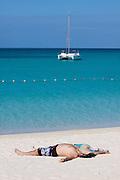 Miyako-jima. Maehama - Japan's most beautiful beach. A guest of Miyakojima Tokyu Resort having a nap.