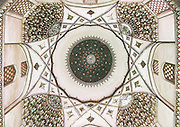 Stunning photographs reveal the beautiful ceilings in Iran's mosques, bazaars and public baths<br /> <br /> For the past few decades, restrictions on travel to Iran has meant the country has been largely shut off from the Western world, but as visa sanctions are lifted in the light of a landmark nuclear deal, the local tourism industry is hoping for a flurry of visitors.<br /> It's not hard to see why Iran is listed as one of the top travel destinations of 2016, with its rich culture and history. <br /> Among the standout aspects of the nation is its beautiful ancient architecture, with the cities and towns littered with ornate and eye-catching mosques, public baths and markets. <br /> And unlike many other countries - the roof is not an afterthought, with many ceilings built as the centrepiece to the building, with many of the tile designs showcasing a display of intricate geometric patterns that date back several centuries. <br /> French photographer Eric Lafforgue has travelled the country photographing the ceilings of indoor markets, mosques and bath houses. <br /> <br /> Photo shows: ceiling with its intricate and elaborate patterns in three domes moshtaghie, Central County, Kerman, Iran