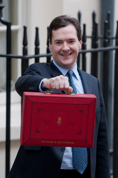 George Osborne, outside number 11 Downing Street, holds the speech he will later give to Parliament on the following year's budget.