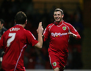 London - Tuesday, March 4th, 2008: Jamie Cureton of Norwich City celebrates his equalising goal with Lee Croft against Watford during the Coca Cola Champrionship match at Vicarage Road, London. (Pic by Chris Ratcliffe/Focus Images)