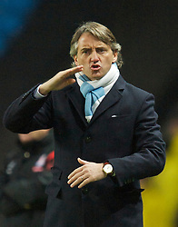 MANCHESTER, ENGLAND - Sunday, February 13, 2010: Manchester City manager Roberto Mancini during the FA Cup 5th Round match against Stoke City at the City of Manchester Stadium. (Photo by David Rawcliffe/Propaganda)  MANCHESTER, ENGLAND - Sunday, February 13, 2010: Manchester City xxxx and Stoke City's xxxx during the FA Cup 5th Round match at the City of Manchester Stadium. (Photo by David Rawcliffe/Propaganda)