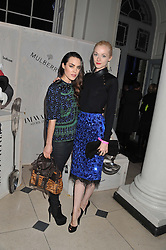 Left to right, TALULLAH HARLECH and PORTIA FREEMAN at a private view of Story Teller by photographer Tim Walker supported by Mulberry held at Somerset House, The Strand, London on 17th October 2012.