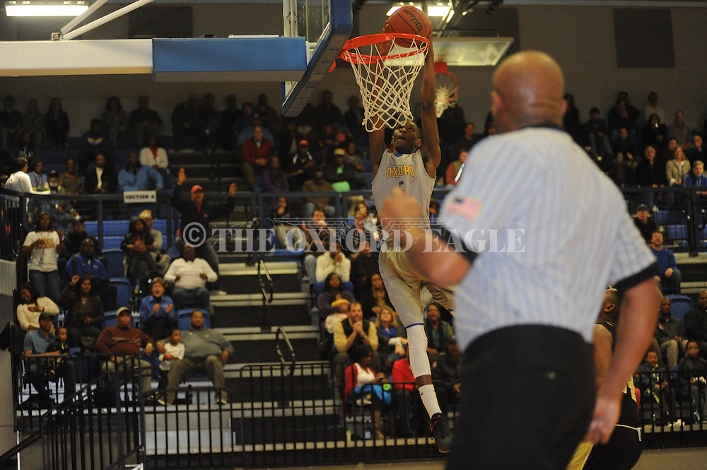 Oxford High's Shelby McEwen (5) dunks against New Hope in Oxford, Miss. on Friday, February 6, 2015.