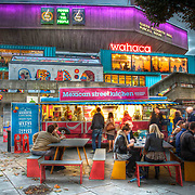I really enjoy photographing the city at night, capturing the bright lights and vibrant colours. When the Wahaca pop-up restaurant turned up on the Thames Southbank almost overnight I headed straight down there with my camera.<br />
