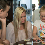 ROYAL PALM BEACH, FLORIDA, MARCH 15, 2017<br /> Cynthia Greaux plays a card game called &quot;Spot It&quot; with her children; Tyler, 14, and Chloe, 8, in their home. Greaux is able to use vouchers to pay for their enrollment at a private school that specializes in educating children with dyslexia.<br /> (Photo by Angel Valentin/Freelance)