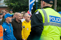 After hiolding thier rally EDL Supporters turn their attention towards a UAF  counter protest while being escorted out of Hexthorpe back into Doncaster Town Centre on Saturday. The EDL and UAF are thought to have chosen Hexthorpe after recent media reports of tension between newly arrived Roma residents and the the local community<br /> 19 July 2014<br /> Image © Paul David Drabble <br /> www.pauldaviddrabble.co.uk