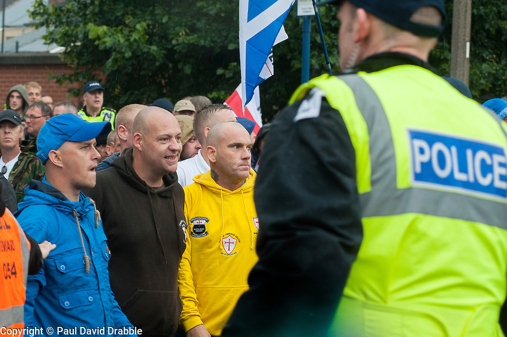 After hiolding thier rally EDL Supporters turn their attention towards a UAF  counter protest while being escorted out of Hexthorpe back into Doncaster Town Centre on Saturday. The EDL and UAF are thought to have chosen Hexthorpe after recent media reports of tension between newly arrived Roma residents and the the local community<br /> 19 July 2014<br /> Image &copy; Paul David Drabble <br /> www.pauldaviddrabble.co.uk