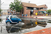 "Annapolis, Maryland - June 05, 2016: A tiny Smart Car drives through a sizable puddle in front of the Harbor Master's office on Dock Street in Historic Annapolis Sunday Morning June 5th, 2016. The puddle is an example of nuisance flooding and was exacerbated by the morning's perigean spring tide.<br /> <br /> <br /> A perigean spring tide brings nuisance flooding to Annapolis, Md. These phenomena -- colloquially know as a ""King Tides"" -- happen three to four times a year and create the highest tides for coastal areas, except when storms aren't a factor. Annapolis is extremely susceptible to nuisance flooding anyway, but the amount of nuisance flooding has skyrocketed in the last ten years. Scientists point to climate change for this uptick. <br /> <br /> <br /> CREDIT: Matt Roth for The New York Times<br /> Assignment ID: 30191272A"