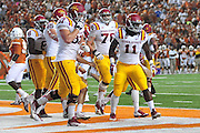 AUSTIN, TX - OCTOBER 18:  E.J. Bibbs #11 of the Iowa State Cyclones celebrates with teammates after scoring a touchdown against the Texas Longhorns on October 18, 2014 at Darrell K Royal-Texas Memorial Stadium in Austin, Texas.  (Photo by Cooper Neill/Getty Images) *** Local Caption *** E.J. Bibbs