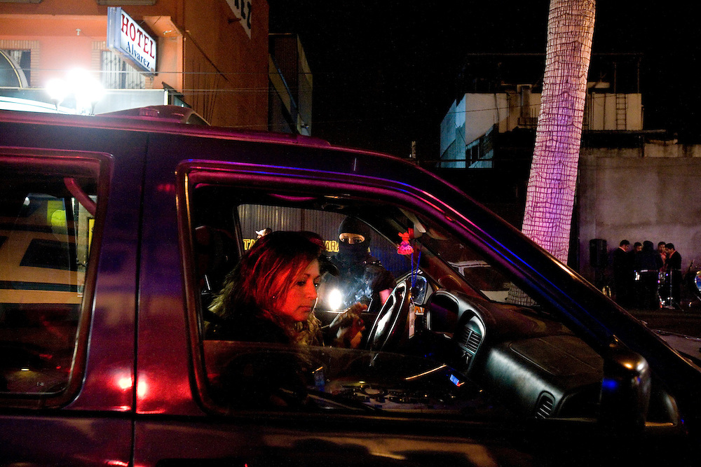 A night operation  by the Tijuana's Special Tactics Unit checking cars and people for cocaine and narcotics, Monday, March 9, 2009.  .
