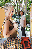 Two women holidaymakers with  luggage