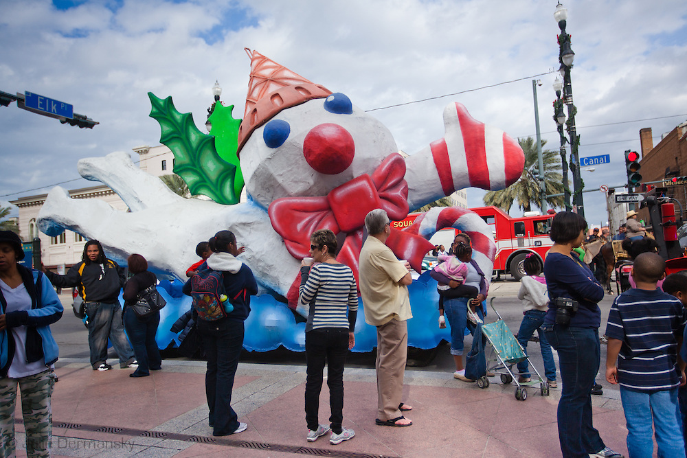 "December 3, 2011,  Mr. Bingle snowman float in the New Orleans' official holiday parade, hosted by the ""Krewe of Jingle,"" on Canal Street kicking off holiday celebrations. New Orleans tourist industry is showcasing New Orleans as a Christmas travel destination."