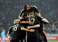 Fotball<br /> VM 2010<br /> Bronsefinale<br /> Tyskland v Uruguay<br /> 10.07.2010<br /> Foto: Witters/Digitalsport<br /> NORWAY ONLY<br /> <br /> Jubel 2:3 Sami Khedira, oben Jerome Boateng (Deutschland)<br /> Fussball WM 2010 in Suedafrika, Spiel um Platz 3, Uruguay - Deutschland 2:3