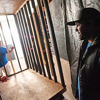 100313       Cable Hoover<br /> <br /> Cousins Ernie Santiago, right, and Greg Santiago double check the spinning cage feature in their latest haunted house construction in downtown Gallup Thursday.