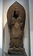 Standing stone statue of a Buddha. Chinese Qi Dynasty circa 550 AD