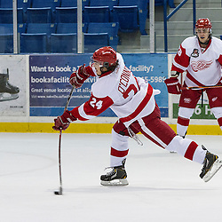 OAKVILLE, ON - Sep 27, 2014 : Ontario Junior Hockey League game action between Hamilton and Wellington at the Governors Showcase Tournament, Jason O'Connor #24 of the Hamilton Red Wings Hockey Club shoots the puck during the first period.<br /> (Photo by Stephen DiNallo / OJHL Images)
