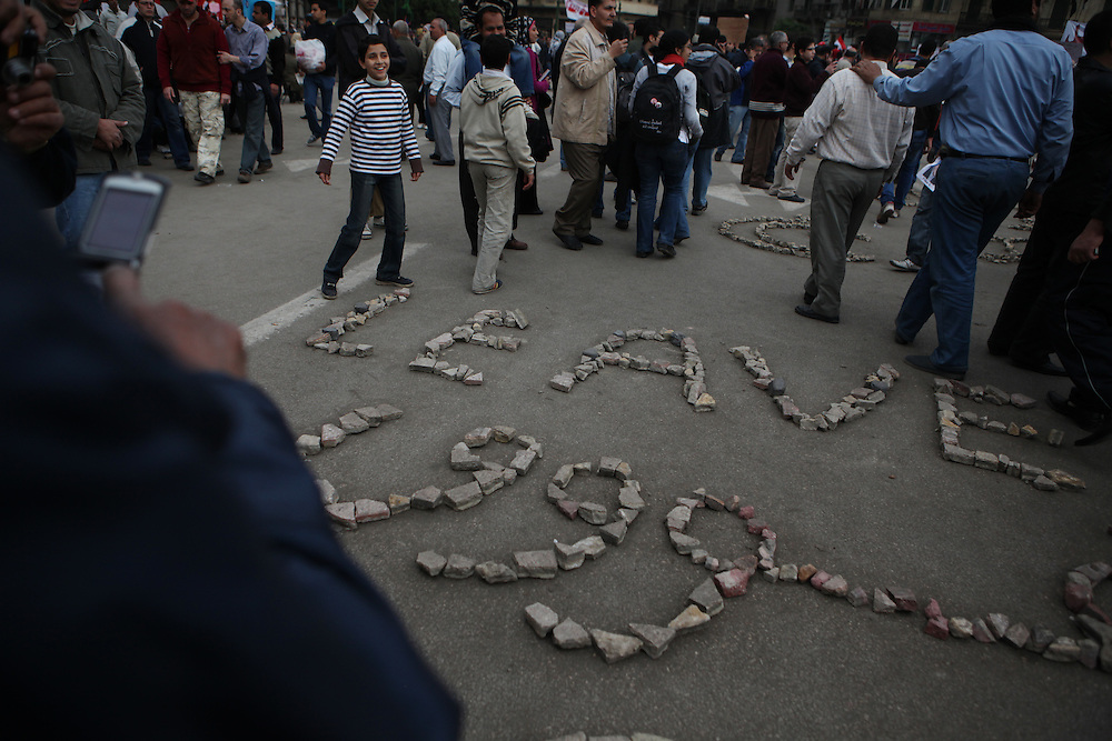 "On ""Sunday of the martyrs"" at Tahrir Square, pro-democracy protesters arrange rocks in the shape of the word ""leave."""