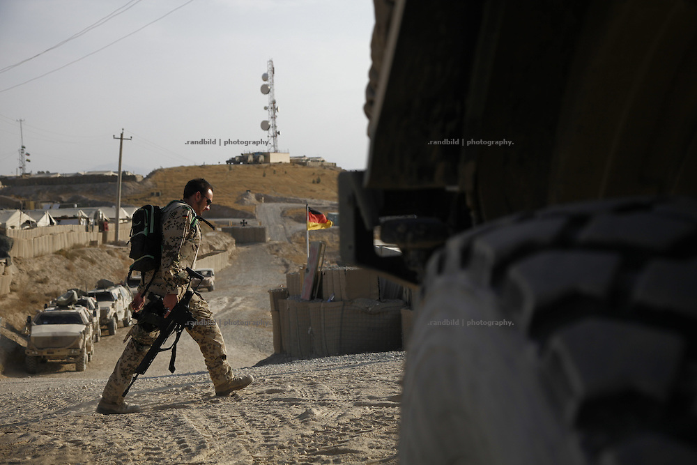 A soldier walks through german OP North, Northern Afghanistan