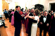March 6, 2016 - NANCY REAGAN, Ronald Reagan's widow and First Lady from 1981-1989, has died at 94. The cause of death was congestive heart failure. Pictured: February 6, 1981 - The White House, Washington, DC, U.S. - U.S. President RONALD WILSON REAGAN and friends celebrate his 70th birthday and first one in the White House. First Lady NANCY REAGAN dances with legendary movie star FRANK SINATRA, 'Old Blue Eyes', as President Reagan attempts to 'cut-in' on the dance floor in the White House's East Room.<br /> ©Michael Evans/Exclusivepix Media