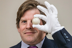 Bonhams Sporting Sale will take place on Wednesday 1 May in Edinburgh. The sale will include the oldest golf scorecard in the world.<br /> <br /> Pictured: A white painted feather golf ball, handmade in around 1840 by Allan Robertson (1815-1859), one of most gifted of the early professional golfers held by Hamish Wilson, Senior Valuer and Golf Specialist at Bonhams. Estimate: £3,000-5,000.