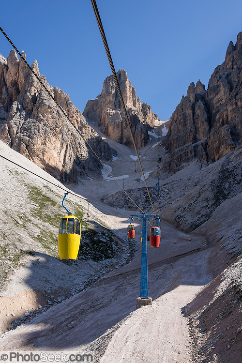 A lift to Forcella Staunies on Monte Cristallo gives unforgettable views over the Sesto and other Dolomites mountains near Cortina d'Ampezzo, in the Province of Belluno, Veneto region, Italy, Europe. Monte Cristallo lies within Parco Naturale delle Dolomiti d'Ampezzo. Directions: From Cortina, drive 6km east on SR48 to the large parking lot for Ski Area Faloria Cristallo Mietres (just west of Passo Tre Croci Federavecchia). Take a chair-lift from Rio Gere to Son Forca (rising from 1698m to 2215m). Then take the old style ovovia (egg-shaped) Gondellift Forcella Staunies to Rifugio Guido Lorenzi (2932m) for astounding views. Climbers enjoy spectacular via ferrata routes here. The ski resort of Cortina d'Ampezzo (Ladin: Anpëz, German: Hayden, at 1224 meters/4016 feet) lies at the head of Valle del Boite surrounded by the beautiful Dolomiti, part of the Southern Limestone Alps. Cortina gained worldwide fame after hosting the 1956 Winter Olympics. UNESCO honored the Dolomites as a natural World Heritage Site in 2009.