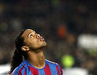 Photo: Chris Ratcliffe.<br /> Barcelona v Chelsea. UEFA Champions League. 07/03/2006.<br /> Ronaldinho looks to the sky