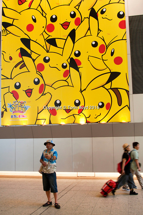 August 7, 2016, Yokohama, Japan: This is the Queen's Square shopping mall decorated with Pikachu motifs throughout the shopping complex. This was part of Pikachu Outbreak!, a weeklong extravaganza dedicated to Pikachu, the lovable Pokemon character held in Yokohama from August 7 -14, 2016. This annual summer event started in 2014 involves hundreds of Pikachu mascots and huge inflatables making appearances at venues throughout the city's waterfront district known as Minato Mirai. Events include a parade of dancing Pikachu mascots, a large gathering of Pikachu splashing themselves and fans, a hula dance event, a Pikachu fishing pool, stage performances, Pikachu merchandise for sale and Pikachu photo studios. (Torin Boyd/Polaris).
