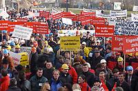 07 NOV 2002, BERLIN/GERMANY:<br /> Demonstraten mit Schildern, Demonstration gegen die Kuerzung der Eigenheimzulage, am Startpunkt Alexanderplatz<br /> IMAGE: 20021107-01-025<br /> KEYWORDS: Demo, Bau, Baugewerbe, Kürzung, Demostrant, demonstrator, Subventionen