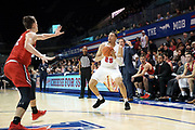SMU Mustangs forward Ethan Chargois (25) attempts to draw Hartford Hawks forward Miroslav Stafl (12) with a head fake while Hawks coach Joe Gallagher looks on during an NCAA college basketball game, Wednesday, Nov. 27, 2019, in Dallas.SMU defeated Hartford 90-58. (Wayne Gooden/Image of Sport)