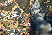 San Marcos, California, U.S. - <br /> <br /> California Wildfires 2014 - Cocos Fire<br /> <br /> Aerial view form helicopter of Cocos Fire as it burns near homes and CSU San Marcos.  <br /> ©Exclusivepix