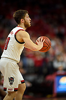 Wolfpack guard Braxton Beverly (10) looks to pass during ACC action in PNC Arena.