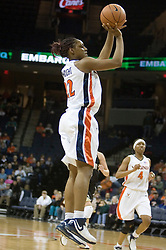 Virginia first-year Monica Wright (22) shoots a jump shot against Wake Forest.  The Cavaliers defeated the Demon Deacon 77-71 on January 11, 2007 for their first ACC win in the John Paul Jones Arena in Charlottesville, VA.<br />
