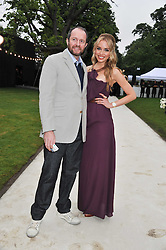 SCOTT YOUNG and NOELLE RENO at the annual Serpentine Gallery Summer Party sponsored by Burberry held at the Serpentine Gallery, Kensington Gardens, London on 28th June 2011.