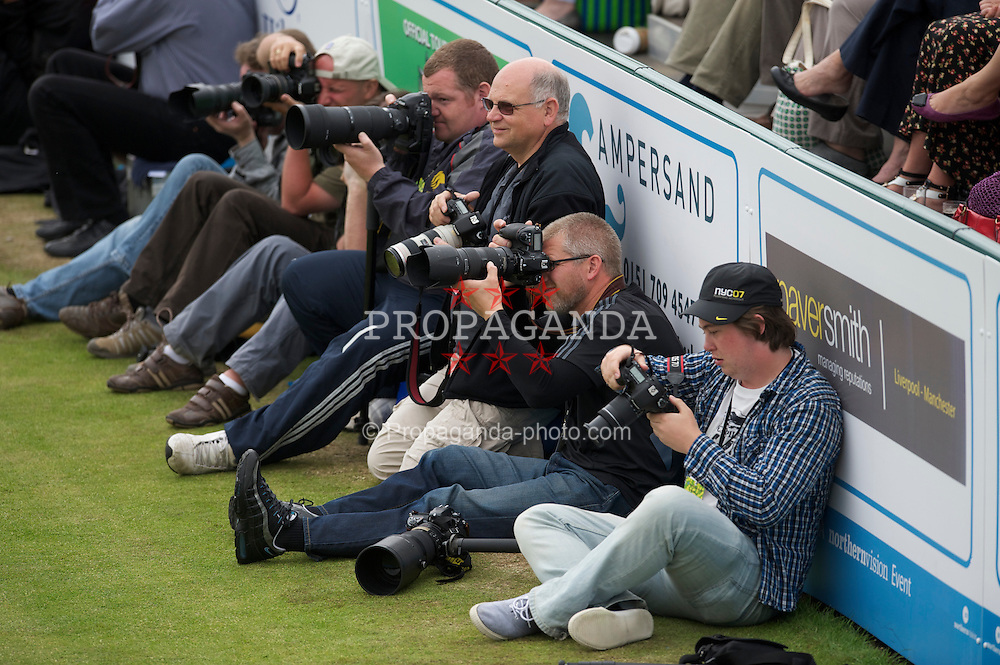 LIVERPOOL, ENGLAND - Friday, June 18, 2010: Photographers during the Mixed Doubles on day three of the Liverpool International Tennis Tournament at Calderstones Park. (Pic by David Rawcliffe/Propaganda)