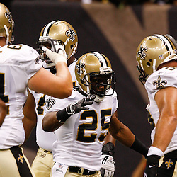 August 21, 2010; New Orleans, LA, USA; New Orleans Saints running back Reggie Bush (25) celebrates a touchdown during the first quarter of a preseason game at the Louisiana Superdome. Mandatory Credit: Derick E. Hingle