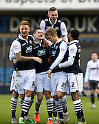 Millwall midfielder Shaun Williams celebrates his goal with team mates during the Sky Bet League 1 match between Millwall and Bury at The Den, London, England on 28 November 2015. Photo by David Charbit.
