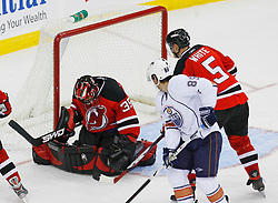 Nov 9, 2008; Newark, NJ, USA; New Jersey Devils goalie Scott Clemmensen (35) makes a save during the second period of their game against the Edmonton Oilers at the Prudential Center.