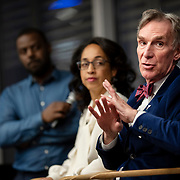 April 17, 2018 - New York, NY : The New York Times hosted Bill Nye for a conversation about climate change with New York Times science writer James Gorman and NYC Rising producer Geraldine Moriba at the Times building on Tuesday evening. Here, from left, BlocPower CEO and co-founder Donnel Baird, Moriba, and Nye during the event.  CREDIT: Karsten Moran for The New York Times