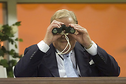 MONACO, FRANCE - Friday, August 24, 2001: UEFA President Lenart Johansen uses binoculars to view Liverpool's UEFA Super Cup win at the Stade Louis II in Monaco. (Pic by David Rawcliffe/Propaganda)