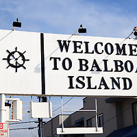 Welcome to Balboa Island sign for the Balboa Island Ferry in Newport Beach California. The Balboa Island Ferry has been operating since 1919 and transports people and cars from Balboa Island to Balboa Peninsula across Newport Harbor (Newport Bay). Newport Beach is located along the Pacific Ocean in Orange County California in the United States.