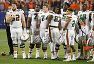 The University of Miami Hurricane's offensive team look on as the Clemson Tigers hold the lead late in the ACC Championship Game at Bank of America Stadium in Charlotte, N.C. on Saturday, December 2, 2017.