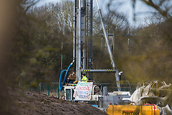 Harefield, UK. 18 February, 2020.  Two environmental activists, including former Paralympic cyclist James Brown (r) of Extinction Rebellion, are locked onto a drilling rig, displaying a banner which reads: 'Protect London's drinking water. Stop HS2', at a site in the Colne Valley currently being used for the HS2 high-speed rail link. According to the activists from Stop HS2, Save the Colne Valley and Extinction Rebellion, HS2 are intending to use the rig to drill into the aquifer which supplies 22% of London's drinking water, risking contamination.