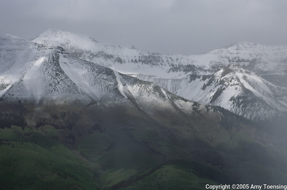 TELLURIDE, CO- JUNE 12: Snow sweeps over a mountain ridge, June 12, 2005 in Telluride, CO. This is the new habitat for the reintroduced lynx in the Colorado Division of Wildlife Lynx Reintroduction Program. In 1999 the Colorado Division of Wildlife (CDOW) began a lynx reintroduction program, trapping the animals in Canada and bringing them to Colorado. The goal is to re-establish the lynx population in the state, which has been nonexistent since the 1970s, to a viable level where the population that can sustain itself. The program has brought in 204 lynx between 1999 and 2005. There have been 71 known deaths, and 101 kittens born. The program is considered widely as a success, however the program has also instigated controversy protests from animal rights groups and developers. (Photo by Amy Toensing) _________________________________<br />