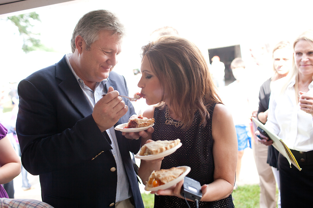 Marcus Bachmann feeds pie to  his wife, GOP Presidential candidate Rep. Michele Bachmann, during a campaign stop at the Story County Fair in Nevada, Iowa, July 23, 2011.