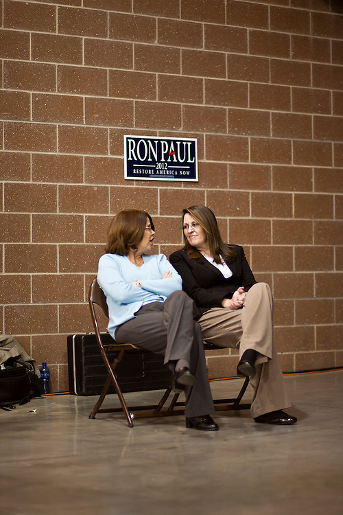 Two women sit backstage as Republican presidential candidate Ron Paul speaks at a Salute to Veterans Rally on Wednesday, December 28, 2011 in Des Moines, IA.