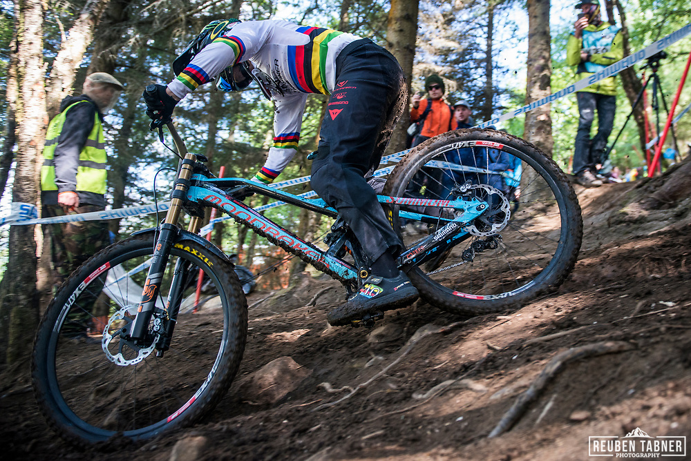 World Champion Danny Hart shows off his stripes on his matching shoes as he blasts through the woods during his qualifying run of the UCI Mountain Bike World Cup at Fort William.